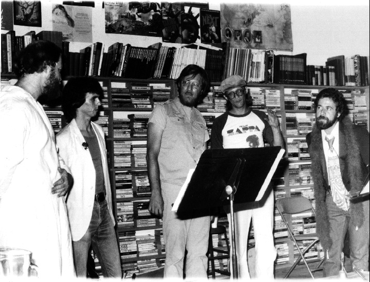 Dallas poet Joe Stanco (center) with VICTOR DADA performance ensemble at Paperbacks Plus bookstore in Mesquite, Texas, 1981. Photo by Ron DeJulius.